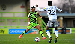 Udoka Godwin-Malife of Forest Green Rovers tries to get past Brendan Sarpong-Wiredu of Colchester United- Mandatory by-line: Nizaam Jones/JMP - 27/02/2021 - FOOTBALL - The innocent New Lawn Stadium - Nailsworth, England - Forest Green Rovers v Colchester United - Sky Bet League Two