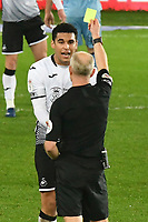 Football - 2020 / 2021 Sky Bet Championship - Swansea City vs Coventry City - Liberty Stadium<br /> <br /> Andy Woolmer shows the yellow card ro Ben Cabango Swansea<br /> <br /> COLORSPORT/WINSTON BYNORTH