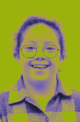 Portrait of young girl with Downs Syndrome wearing glasses smiling,