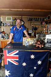 EXCLUSIVE: An Australian man has created his own Outback outpost 11,000 miles from home on the Shetland Islands – and he even has WALLABIES. Tasmanian Dave Kok, 42, has built his own Aussie oasis on the Scottish archipelago after deciding to settle there when he was travelling Europe. Now Dave lives with his Shetland native wife Louise, 38, and two daughters Caitlin, 11, and Ruby, aged four. Social care worker Dave came to the islands in the late 90s and since 2016 has been building his own watering hole choc-full of Australiana on the island of Burra. Dave's place 'The Outpost' is a renovated wooden porta cabin filled with Tasmanian beers, Tim Tams, books on bush craft and Aussie Rules sporting memorabilia. Locals use the Outpost as their local bar and meeting place, as the nearest pub or café is three bridges and three islands away. And visitors can now enjoy the Outpost's wallabies Ned and Kelly who David brought to the island this winter. Based on the Shetland Islands latitude the marsupials could be the most northerly of their species anywhere on the planet. Dave said visiting Australians are often surprised to find the antipodean paradise in such a remote location. 16 Feb 2018 Pictured: Pic from Dave Donaldson/ Magnus News Agency. Pic shows David Kok behind the bar in his Aussie-themed Outpost in the Shetland Islands. An Australian man has created his own Outback outpost 11,000 miles from home on the Shetland Islands – and he even has WALLABIES. Tasmanian David Kok, 42, has built his own Aussie oasis on the Scottish archipelago after deciding to settle there when he was travelling Europe. Now David lives with his Shetland native wife Louise and two daughters Caitlin, 11, and Ruby, aged four. Social care worker David came to the islands in the late 90s and has built his own watering hole choc-full of Australiana on the island of Burra. David's place 'The Outpost' is a renovated wooden porta cabin filled with Tasmanian beers, Tim Tams, books o