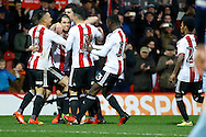 Brentford players celebrate a goal from Brentford midfielder Jota (23) (score 3-2) during the EFL Sky Bet Championship match between Brentford and Rotherham United at Griffin Park, London, England on 25 February 2017. Photo by Andy Walter.