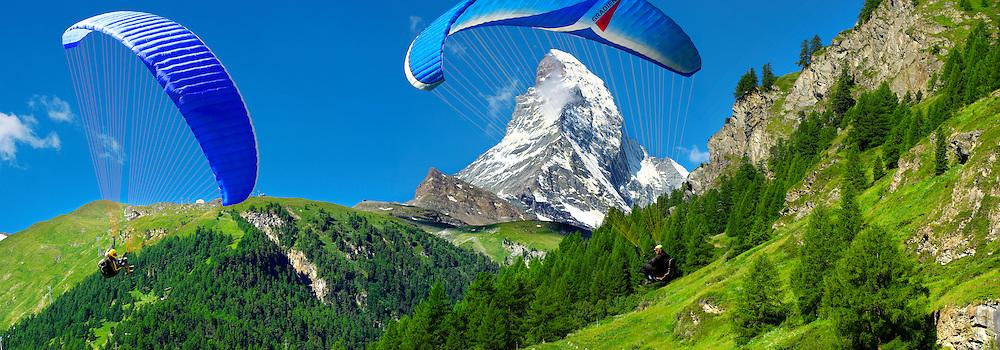 Paragliders over the Matterhorn mountain peak - Swiss Alps - Switzerland