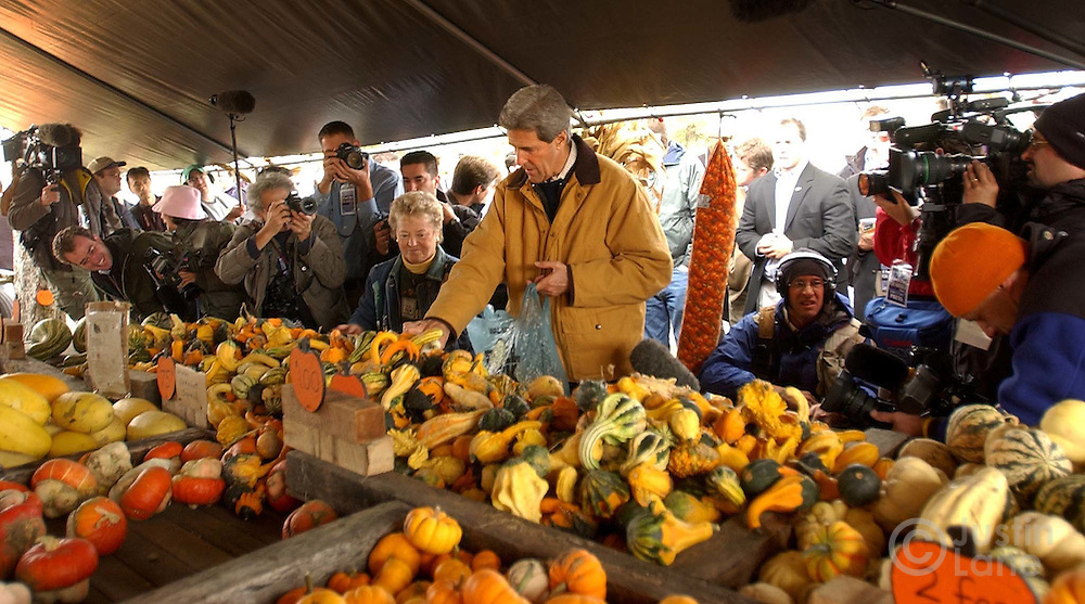 United States Senator and Democratic Candidate for President John Kerry, center, is surrounded by media as he looks over the selection of gourds at the Garringer Family Pumpkin Patch during a campaign stop .on Saturday, 16 October 2004 in Jeffersonvill, OH. ..EPA/JUSTIN LANE