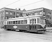 """Y-491121A-01.  """"Portland Traction Co. 800 series for sale"""" Car #800 with sign for NW 23rd.  Nov 21, 1949"""