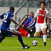 NLD/Amsterdam/20100731 - Wedstrijd om de JC schaal 2010 tussen Ajax - FC Twente, Hyun Jun Suk in duel met Douglas Franco Teixeira