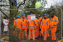 Harefield, UK. 8 February, 2020. HS2, Servest and Skanska engineers warn environmental activists from Extinction Rebellion occupying trees of their intention to fell trees in the area for the high-speed rail project. Using a variety of tactics, the activists were successful in preventing any of the scheduled tree felling by HS2 and after an intervention by a police officer all tree felling and strimming work at the location has now been cancelled for the weekend.