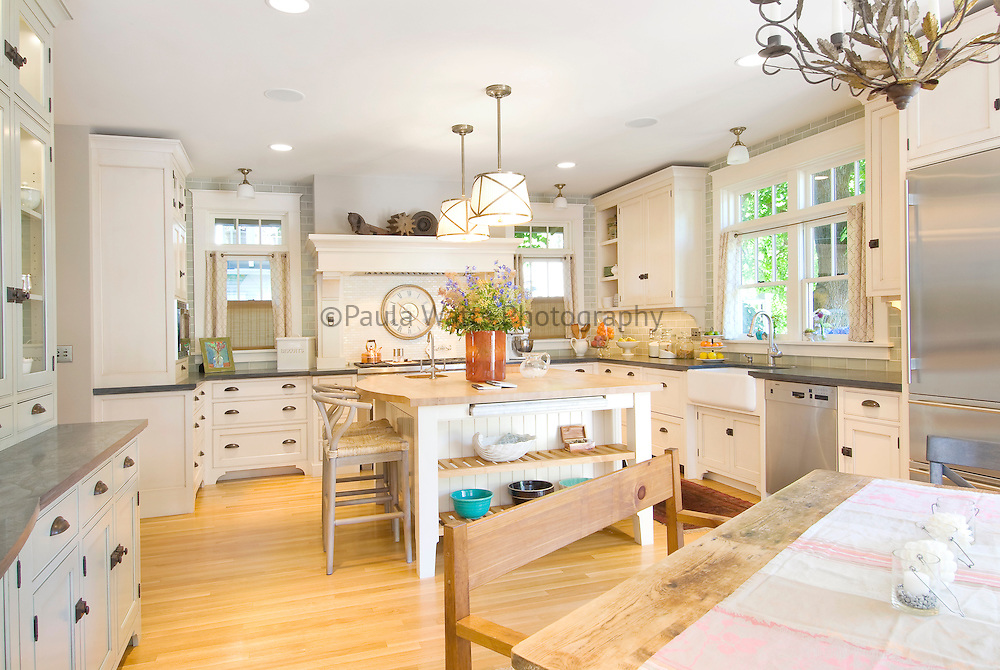 Classical craftsman Kitchen interior remodel with white cabinetry and silver appliances