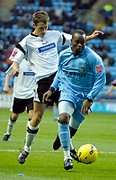 Photo: Ed Godden.<br />Coventry City v Derby County. Coca Cola Championship. 11/11/2006. Stern John (R) takes the ball past Derby's Paul Boertien.