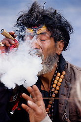 Kathmandu, 18 February 2005.  A Shadu 'Holy Man' is smoking marijuana at the Open Theater, on the occasion of the nation's Democracy Day. The 18th of February is also the Queen's birthday.