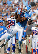 Nov 15, 2009, Nashville, Tennessee, USA;  Kenny Britt(18) of the Tennessee Titans makes a catch over the outstretched arm of Drayton Florence(29) of the Buffalo Bills in the Titans 41-17 win over the Bills at LP Field.