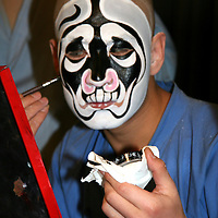 Asia, China, Beijing. Beijing Opera Performer painting face mask.