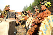 (left to right) Gwyn Evans, 48, Vernon Watkins, 62, Keith Aubrey, 56, and Tony Berg, 58, miners working to restore Unity Mine after 8 years of inactivity are having a laugh under the setting sun after a long day working underground, on Thursday, Apr. 12, 2007, in Cwmgwrach, Vale of Neath, South Wales. They aim to extract 1 million tonnes of coal a year when the site will be ready to full production. The time is ripe again for an unexpected revival of the coal industry in the Vale of Neath due to the increasing prize and diminishing reserves of oil and gas, the uncertainties of renewable energy sources, and the technological advancement in producing energy from coal while limiting emissions of pollutants, has created the basis for valuable investment opportunities and a possible alternative to the latest energy crisis. Unity Mine, in particular, has started a pioneering effort to revive the coal industry in the area, reopening after more than 8 years with the intent of exploiting the large resources still buried underground. Coal could be then answer to both, access to cheaper and paradoxically greener energy and a better and safer choice than nuclear energy as a major supply for the decades to come. It is estimated that coal reserves in Wales amount to over 250 million tonnes, or the equivalent of at least 50 years of energy supply, while the worldwide total coal could last for over 200 years as a viable resource compared to only a few decades of oil and natural gas.