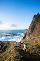 Young women hiking along the Oregon Coast Trail. Oswald West State Park, OR.