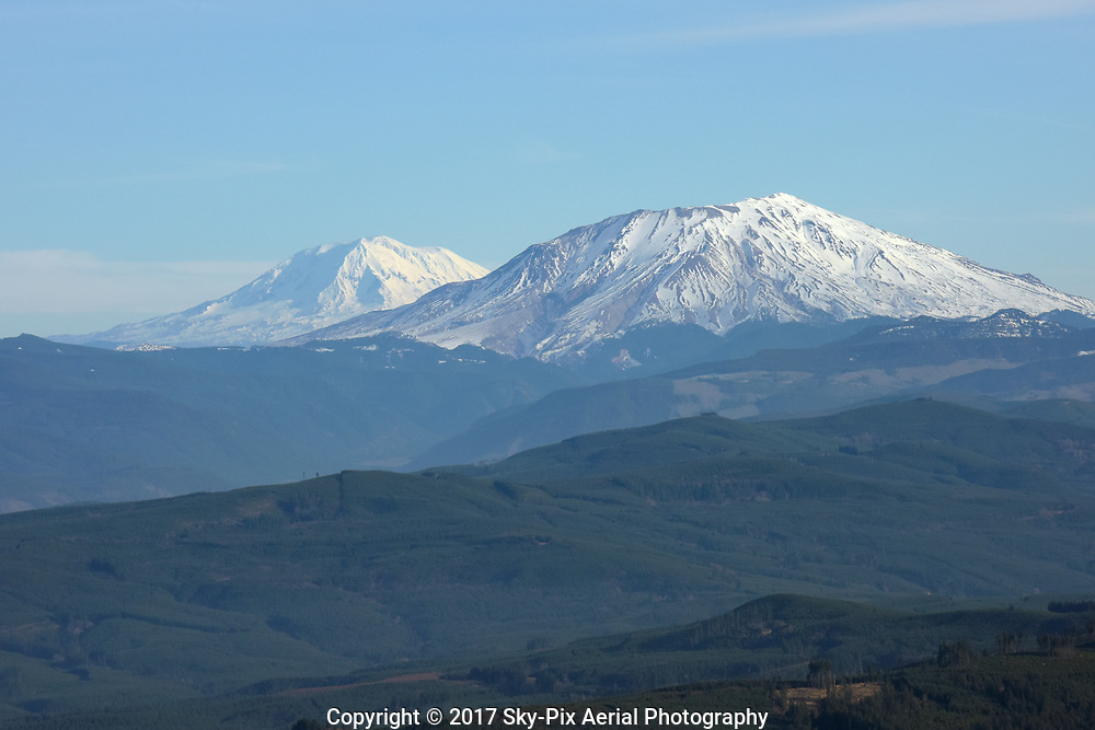 Aerial view from the southwest side of Mount Saint Helens looking toward Mount Rainier.