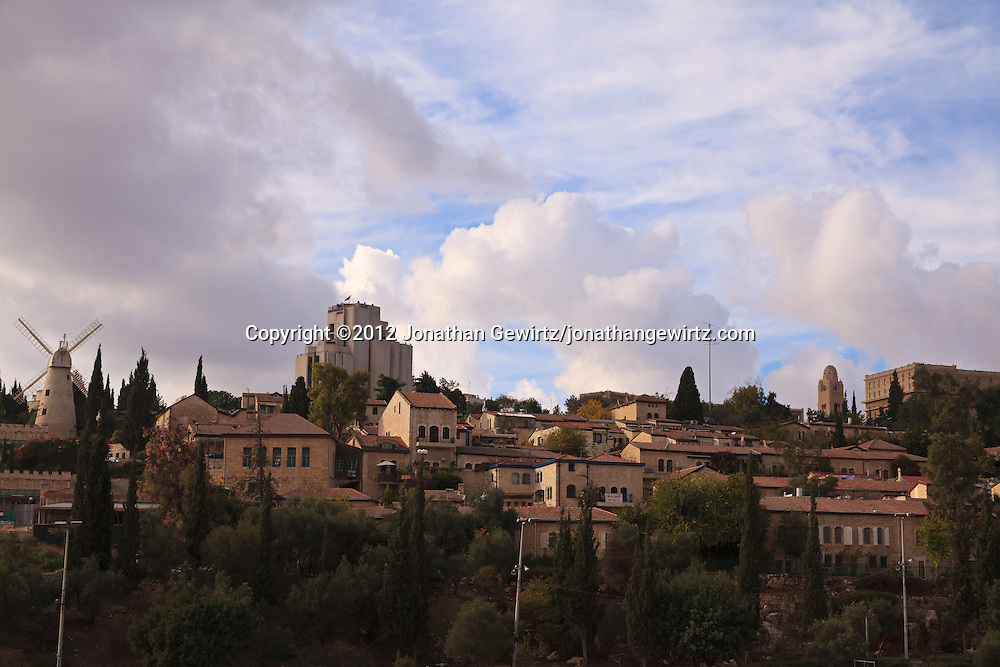 The Moses Montefiore Windmill, King Solomon hotel, YMCA tower and King David hotel stand over the buildings of Yemin Moshe in Jerusalem. WATERMARKS WILL NOT APPEAR ON PRINTS OR LICENSED IMAGES.