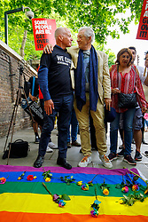 © Licensed to London News Pictures. 02/06/2017. London, UK. MICHAEL CASHMAN and Sir IAN MCKELLEN lay flowers to protest outside the Russian Embassy in London, calling on the Russian authorities to fully investigate reports of a crackdown and torture on LGBTI people in Chechnya. Photo credit: Tolga Akmen/LNP