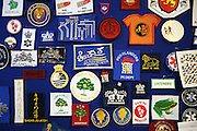 A selection of embroidered badges made by prisoners in the prison workshop. HMP Wandsworth, London, United Kingdom