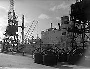 """13/02/1958<br /> 02/13/1958<br /> 13 February 1958<br /> Docks strike: Dublin Port and Alexandra Basin Dock Strike. A view of the idle cranes and the """"S.S. Virginia""""."""