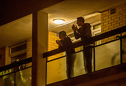 © Licensed to London News Pictures; 26/03/2020; Bristol, UK. Coronavirus Pandemic 2020; people clap from their balconies, windows and doors at 8pm on Thursday evening to applaud NHS health service workers during the UK wide lockdown declared by the prime minister on Monday evening, with the biggest restrictions on freedom of movement ever imposed in the UK. People are told to stay at home except for essential work that cannot be done at home, shopping for food, medical appointments and taking exercise once a day all while maintaining social distance. Photo credit: Simon Chapman/LNP.