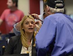 """Claire Danes has her makeup applied during a break between scenes as Showtime brings the production of """"Homeland"""" to the newsroom floor of the Charlotte Observer in Charlotte, NC, USA May 28, 2013. Photo by T. Ortega Gaines/Charlotte Observer/MCT/ABACAPRESS.COM  