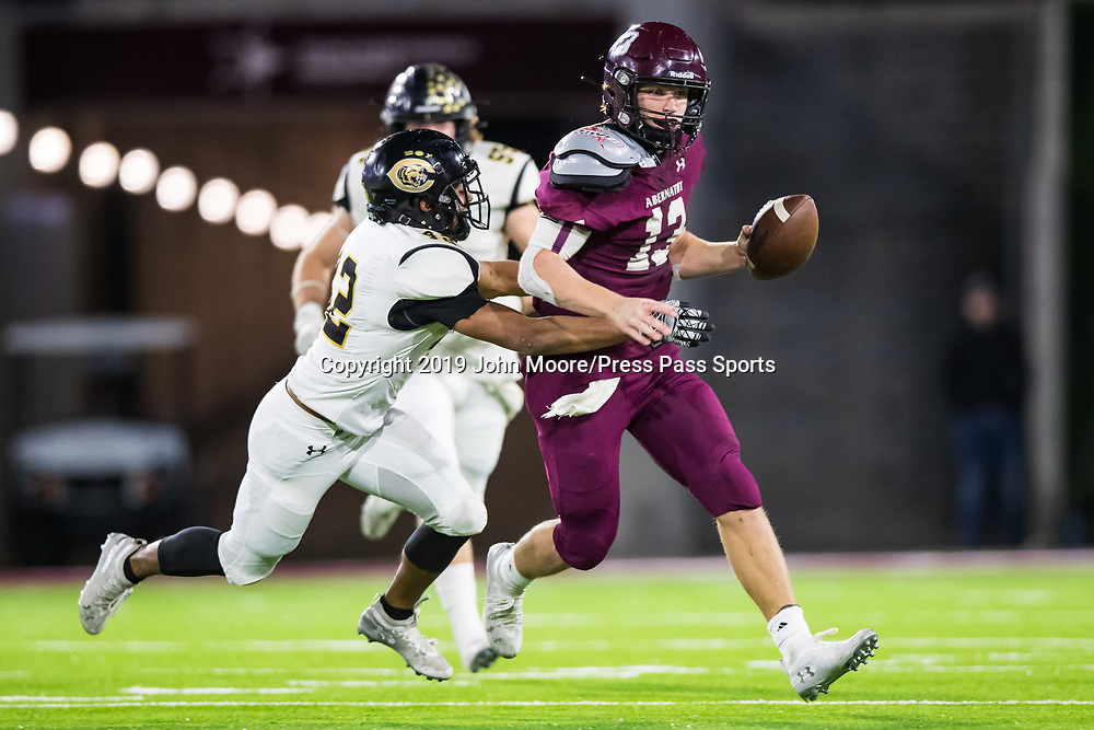 Canadian's Israel Guerrero (42) tackles Abernathy's Bryson Daily (13) in the UIL 3A-D2 Region 1 Championship on Friday, Dec. 6, 2019, at Buffalo Stadium in Canyon, Texas. [Photo by John Moore/Press Pass Sports]