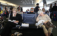 Passengers wait for a delayed flight at Fort Lauderdale Hollywood International Airport. WATERMARKS WILL NOT APPEAR ON PRINTS OR LICENSED IMAGES.