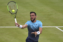 June 19, 2018 - London, England, United Kingdom - Damir Dzumhir (BIH) play against Bulgaria's Grigor Dimitrov during their in the first singles match on day two of Fever Tree Championships at Queen's Club, London on June 19, 2018. (Credit Image: © Alberto Pezzali/NurPhoto via ZUMA Press)