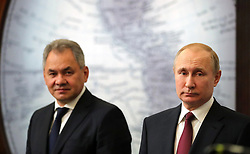 April 27, 2018 - Saint Petersburg, Russia - April 27, 2018. - Russia, Saint Petersburg. - Russian President Vladimir Putin and Defense Minister Sergey Shoigu, Head of the Russian Geographical Society (left), attending the Russian Geographical Society's Trustee Council meeting at the RGS headquarters in St.Petersburg. (Credit Image: © Russian Look via ZUMA Wire)