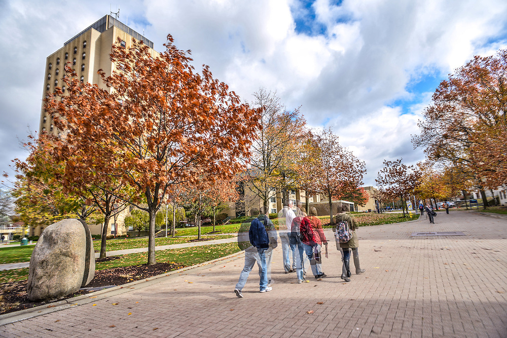 Students walking through campus at The University of Akron.