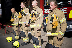 © Licensed to London News Pictures. 11/09/2021. London, UK. Firefighters form North Kensington Fire Station in Notting Hill take part in a minutes silence on the 20th anniversary of the 9/11 terrorist attack. The attacks, which killed a total of 2,977 people, saw passenger jets seized by suicide attackers, flown into the Twin Towers of the World Trade Center in New York and the The Pentagon building. Photo credit: Ben Cawthra/LNP
