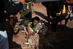 Yekaba Kerebet, 15, is carried to the hospital by her relatives in Bahir Dar, Amhara Region, Ethiopia on May 19, 2007. She had been in labor for three days with her first born. She later developed a fistula, a common result of prolonged obstucted labor and early marriage. Women who have fistulas are often shunned in their villages and thought of a cursed by God.