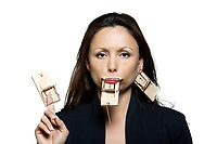 Closeup portrait of beautiful expressive woman with mouse traps in studio isolated on white background