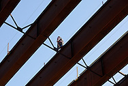 A worker walks along a beam of the new bridge being built over the Neversink River between Exits 107 and 108 on Route 17 in the Town of Thompson on Wednesday, Nov. 14, 2012. Once the new two-lane bridge is complete, the old bridge will be torn down and another new two-lane bridge will be built.