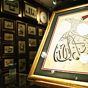 An art store in Istanbul's historic Grand Bazaar sells illustrations, paintings, and calligraphy. The one in the foreground is of the city's famous Whirling Dervish dancers.