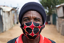 April 29, 2020, Johannesburg, Gauteng, South Africa: Maria Monyai 57 a South African Nationalist wars a mask at the Diepsloot township and explained the hardship as she goes through because for the lock down  in South Africa. (Credit Image: © Manash Das/ZUMA Wire/ZUMAPRESS.com)
