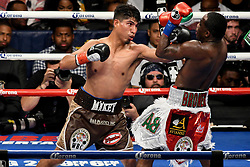July 29, 2017 - Brooklyn, New York, USA - ADRIEN BRONER (green, red, and white trunks) and MIKEY GARCIA battle in a WBC Diamond Belt super lightweight championship bout at the Barclays Center in Brooklyn. (Credit Image: © Joel Plummer via ZUMA Wire)