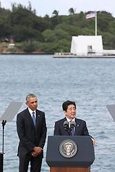 "US-Präsident Barack Obama und Japans Premier Shinzo Abe beim Gedenken an die Opfer des japanischen Angriffs auf Pearl Harbor vor 75 Jahren / 271216<br /> <br /> <br /> <br /> ***Japanese Prime Minister Shinzo Abe (R) gives a speech, along with U.S. President Barack Obama, at Pearl Harbor in Hawaii on Dec. 27, 2016, offering his ""sincere and everlasting condolences"" for those who died in the Japanese attack there in 1941.<br /> ***"