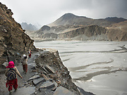 Women returning with potatoes after cutting wood, in Zor Abad, a winter pasture two hour walk from Hussaini village, across the Hunza valley riverbed. Gojal region.