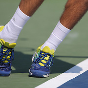 The shoes and sock of Jack Sock, USA, as he serves  against Flavio Cipolla, Italy, during the US Open Tennis Tournament, Flushing, New York. USA. 30th August 2012. Photo Tim Clayton
