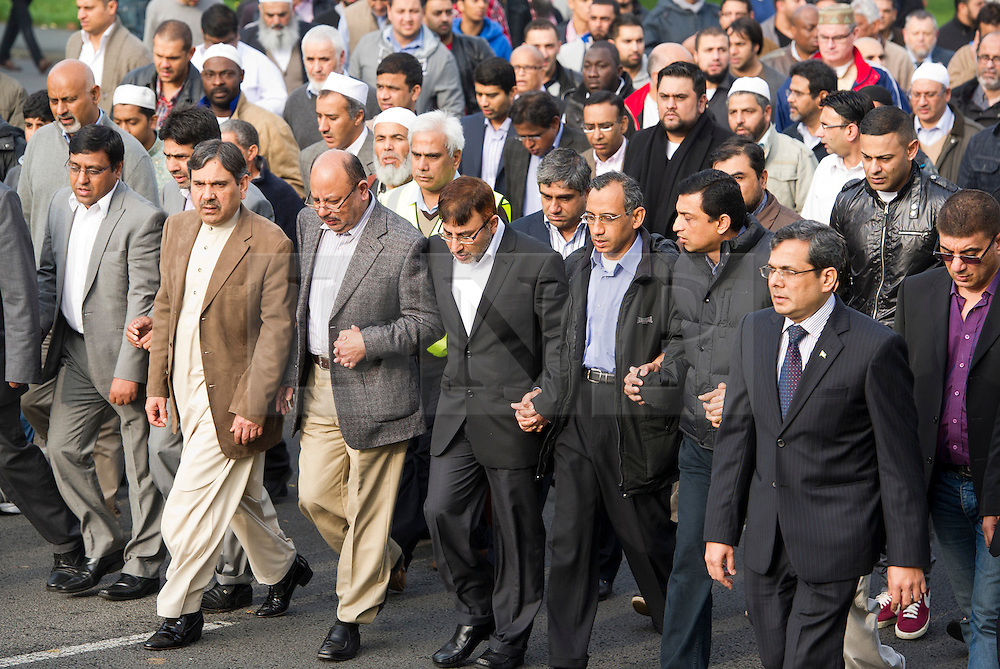 © London News Pictures. 24/10/2012. Harlow, UK. Dr Abdul Shakoor (husband and father, pictured front centre in white shirt and glasses) leading other member of the local Muslim community as they follow the funeral cortege from the Islamic Centre.  The Funeral of Dr Sabah Usmani and her five children Hira (12), Sohaib (11) Muneeb (9), Rayyan (6) and Maheen (3) at Harlow Islamic Centre in Harlow, Essex, UK on October 24, 2012. Dr Sabah Usmani and her five children died blaze at their home in Harlow last week. Photo credit: Ben Cawthra/LNP