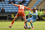 Coventry City midfielder (on loan from Derby County Luke Thomas (23) battles for possession  with Shrewsbury Town midfielder Alex Gilliead (18) during the EFL Sky Bet League 1 match between Coventry City and Shrewsbury Town at the Ricoh Arena, Coventry, England on 28 April 2019.