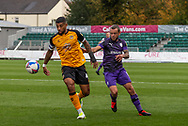 Newport County's Captain Joss Labadie (4) under pressure from Tranmere Rover's Jay Spearing (8) during the EFL Sky Bet League 2 match between Newport County and Tranmere Rovers at Rodney Parade, Newport, Wales on 17 October 2020.