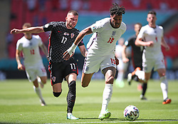 Croatia's Ante Rebic (left) and England's Tyrone Mings battle for the ball during the UEFA Euro 2020 Group D match at Wembley Stadium, London. Picture date: Sunday June 13, 2021.