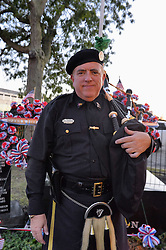 Sept. 11, 2015 - Merrick, New York, United States - KEViN MAC CARTAIGH of Massapequa, a member of NYPD Pipe Band, stands in front of monument at Merrick Memorial Ceremony for Merrick volunteer firefighters and residents who died due to 9/11 terrorist attack at NYC Twin Towers. Ex-Chief Ronnie E. Gies ,of Merrick F.D. and FDNY Squad 288, and Ex-Captain Brian E. Sweeney, of Merrick F.D. and FDNY Rescue 1, died responding to the attacks on September 11, 2001. (Credit Image: © Ann Parry via ZUMA Wire)