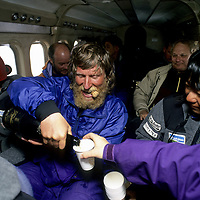 INTERNATIONAL ARCTIC PROJECT. Victor Boyarsky pours champagne as expedition flies home after crossing Arctic Ocean.