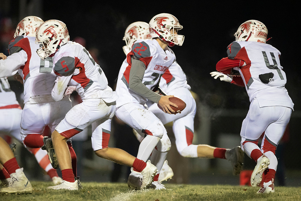 Constantine's Caden Hetzy directs the triple option during the Constantine-Buchanan high school football game on Friday, November 13, 2020, at Memorial Field in Buchanan, Michigan.