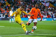 England goalkeeper Jordan Pickford (Everton) clears the ball away from Netherlands Midfielder Georginio Wijnaldum (Liverpool) during the UEFA Nations League semi-final match between Netherlands and England at Estadio D. Afonso Henriques, Guimaraes, Portugal on 6 June 2019.