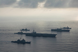 SOUTH CHINA SEA (Aug. 31, 2018) The aircraft carrier USS Ronald Reagan (CVN 76), second from bottom, lead ship of the Ronald Reagan Carrier Strike Group, the guided-missile cruiser USS Antietam (CG 54), bottom, and the guided-missile destroyer USS Milius (DDG 69), left, conduct a photo exercise with the Japan Maritime Self-Defense Force (JMSDF) helicopter destroyer JS Kaga (DDH 184), second from top, and the JMSDF destroyers JS Inazuma (DD 105) and JS Suzutsuki (DD 117). The Ronald Reagan Carrier Strike Group is forward-deployed to the U.S. 7th Fleet area of operations in support of security and stability in the Indo-Pacific region. (U.S. Navy photo by Mass Communication Specialist 3rd Class Erwin Jacob Villavicencio Miciano/Released) 180831-N-VI515-0241