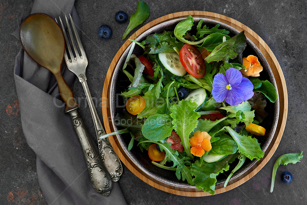 Spring salad, with different leaves, various type of tomatoes, cucumber and edible flowers. Sold exclusively through Stockfood.com
