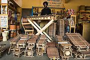 A man plays the xylophone, or balafon, at the Village Artisanal de Ouagadougou, a cooperative that employs dozens of artisans who work in different mediums, in Ouagadougou, Burkina Faso, on Monday November 3, 2008.